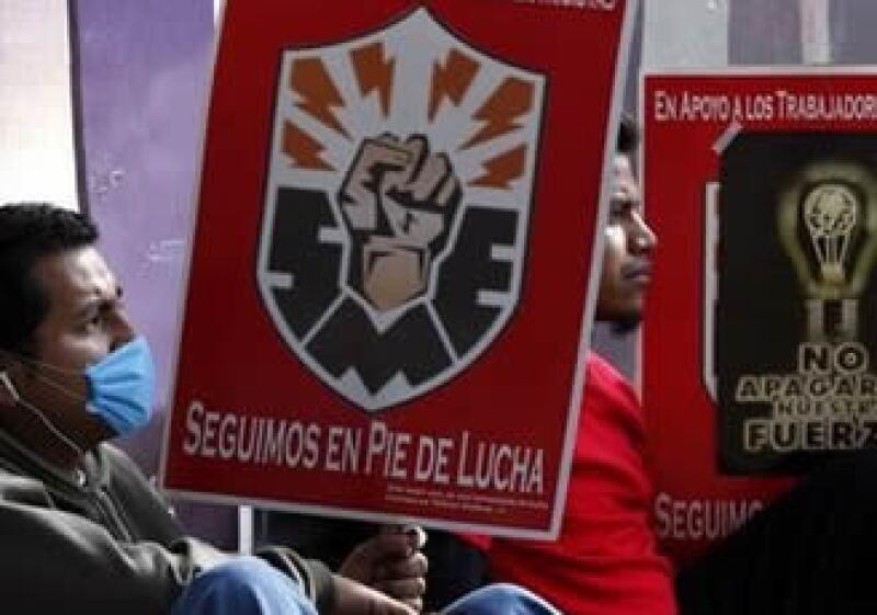 El Gobierno determinó que ex trabajadores liquidados tendrán el servicio de salud con cargo al erario. (Foto: AP)