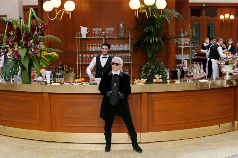 FILE PHOTO -  German designer Lagerfeld appears at the end of his Autumn/Winter 2015/2016 women's ready-to-wear collection for French fashion house Chanel during Paris Fashion Week
