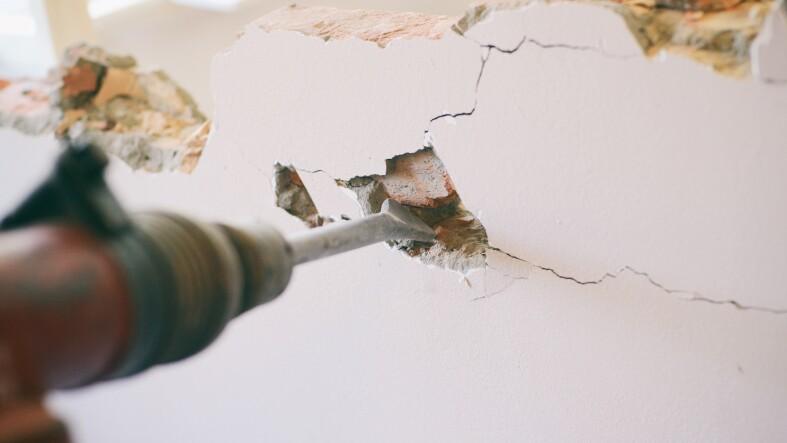 Construction worker using pneumatic hammer