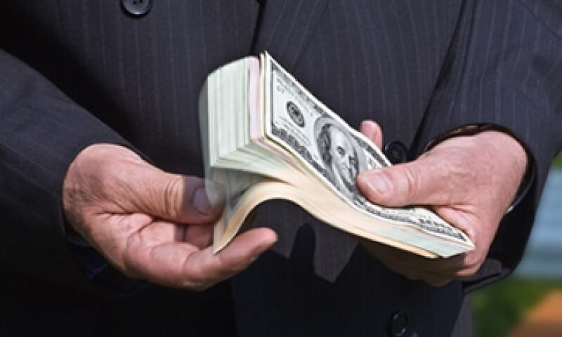 El tipo de cambio es de 13.0188 pesos para solventar obligaciones denominadas en moneda extranjera.  (Foto: Getty Images)