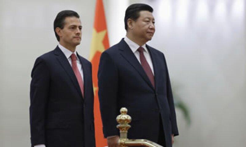 Enrique Peña Nieto viajó en noviembre a China donde su equipo discutió con funcionarios chinos la cancelación del tren México-Querétaro. (Foto: Reuters)