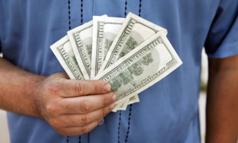 Banco Base espera que el tipo de cambio se ubique entre 13.06 y 13.15 pesos por dólar. (Foto: Getty Images)