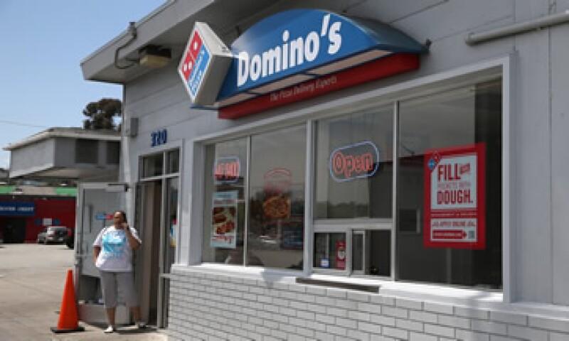 Además de operar a Domino's Pizza y Burger King en España, Grupo Zena es dueño de la marca Foster's Hollywood.(Foto: AFP )