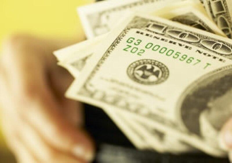 El billete verde cerró la jornada con ganancias frente al peso mexicano. (Foto: Jupiter Images)