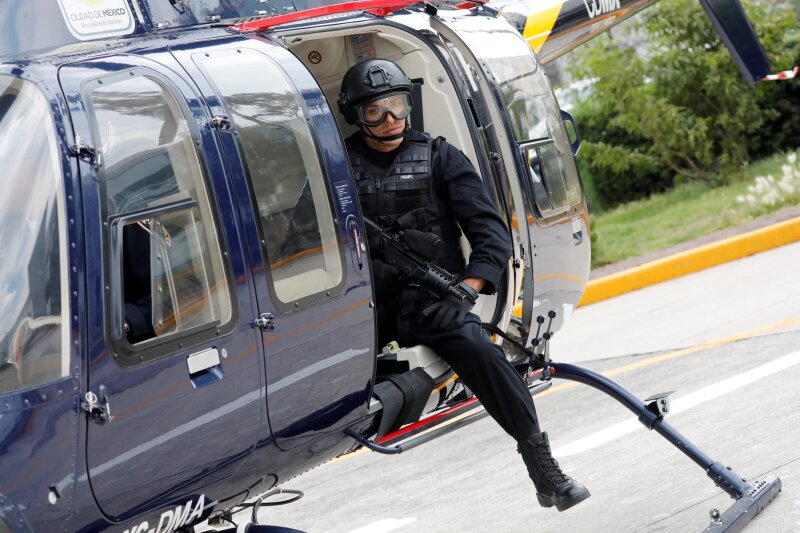 """A police officer, member of a team known as """"Condores"""", is seen after a patrol the city, part of a new strategy to combat the crime in Mexico City"""