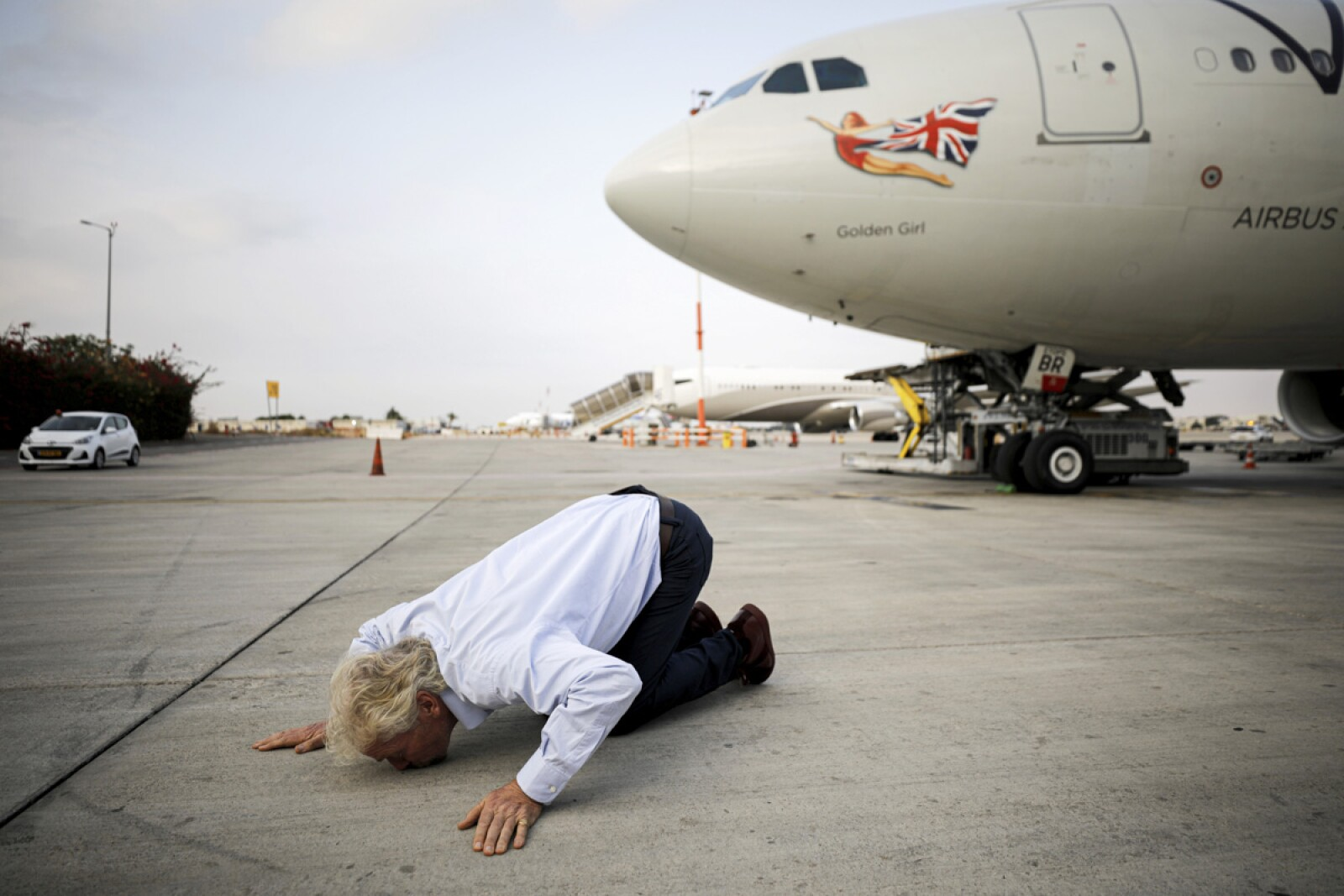 Virgin's Richard Branson kisses the ground as he lands at the Ben Gurion international airport near Tel Aviv