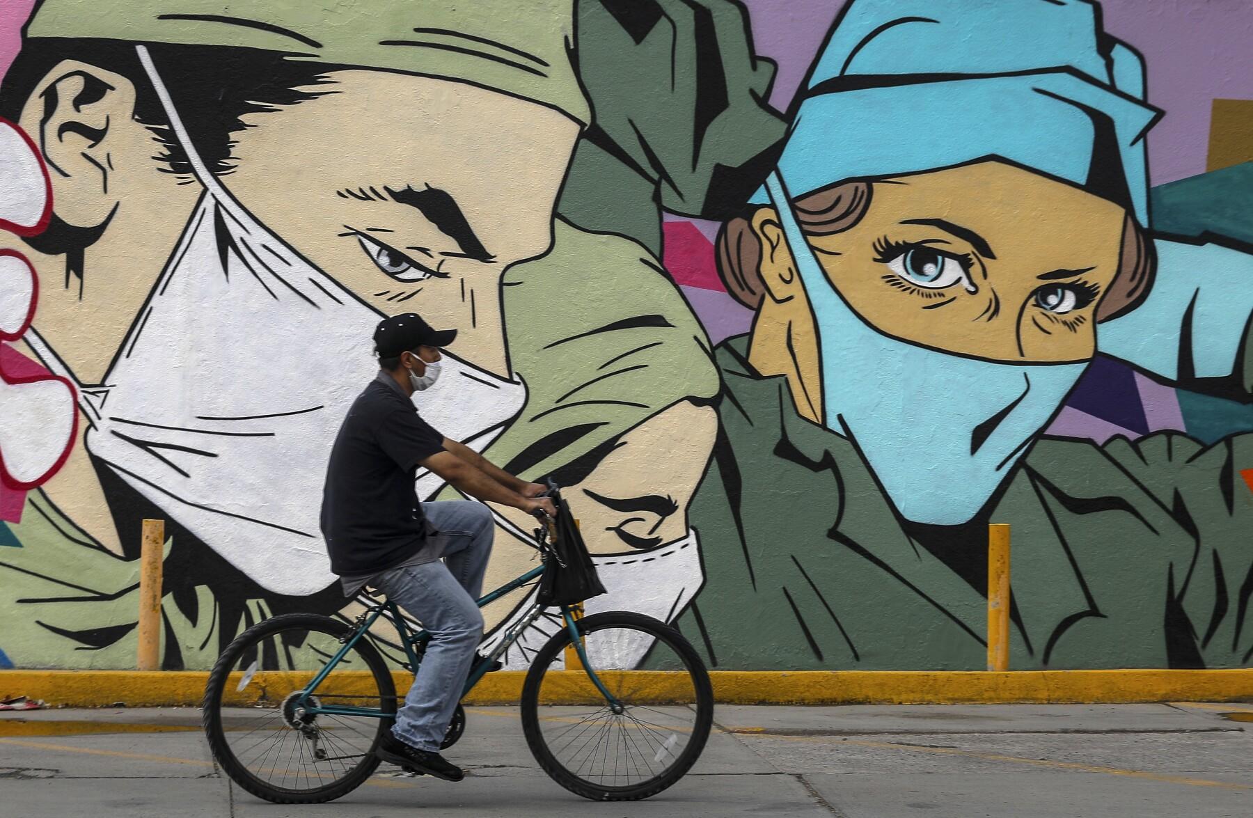 MEXICO-HEALTH-VIRUS-URBAN ART