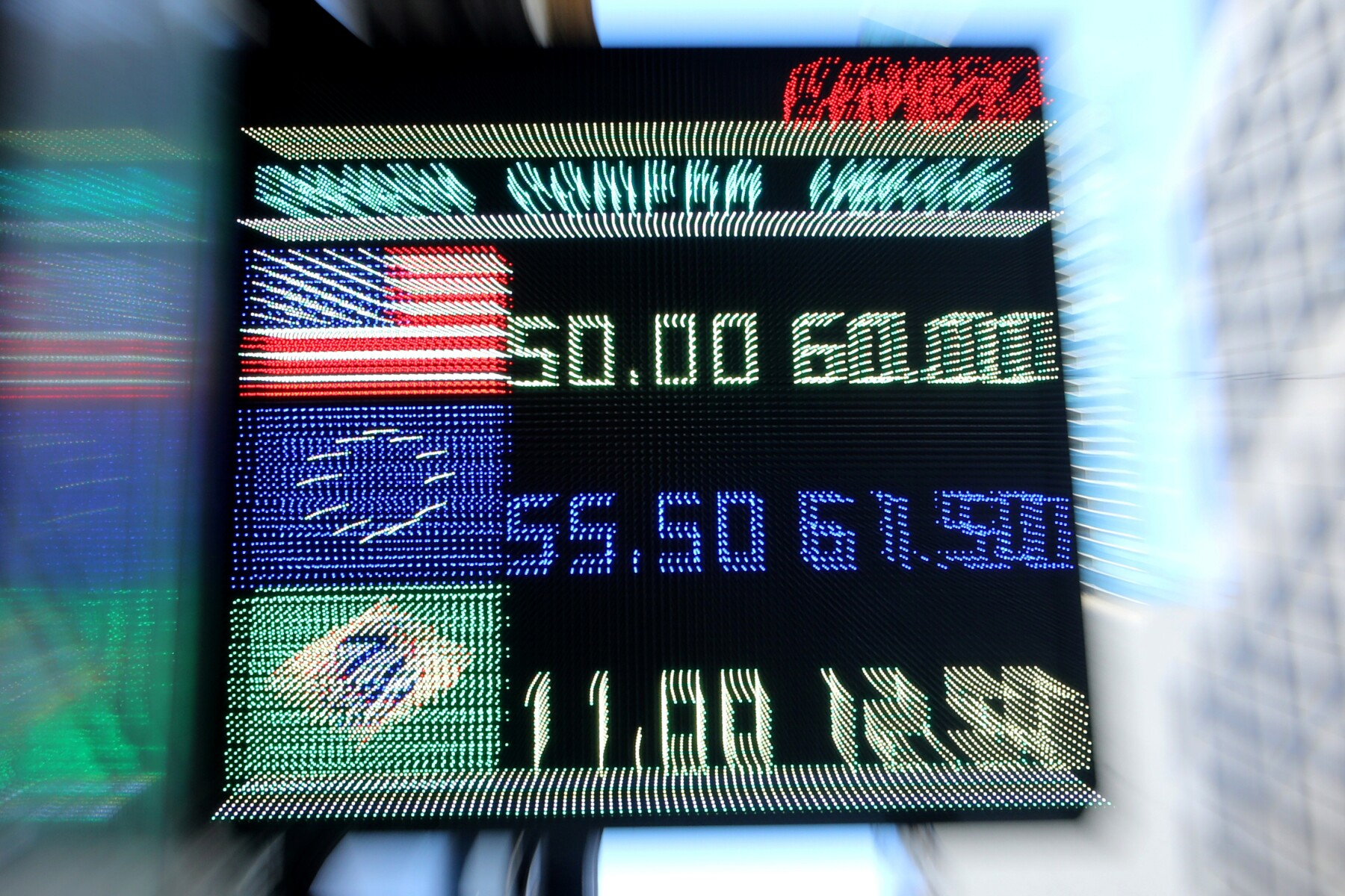 An electronic board shows currency exchange rates in Buenos Aires' financial district