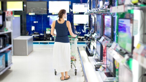 woman chooses a TV in the store