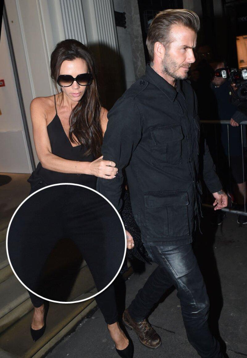La diseñadora de modas y esposa de David Beckham tuvo que abandonar rápidamente la fiesta de aniversario de su tienda.