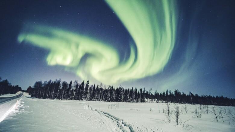 An aurora is seen in the sky in Rovaniemi