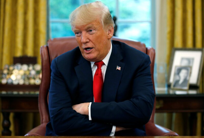 U.S. President Trump answers question during interview with Reuters in the Oval Office of the White House in Washington