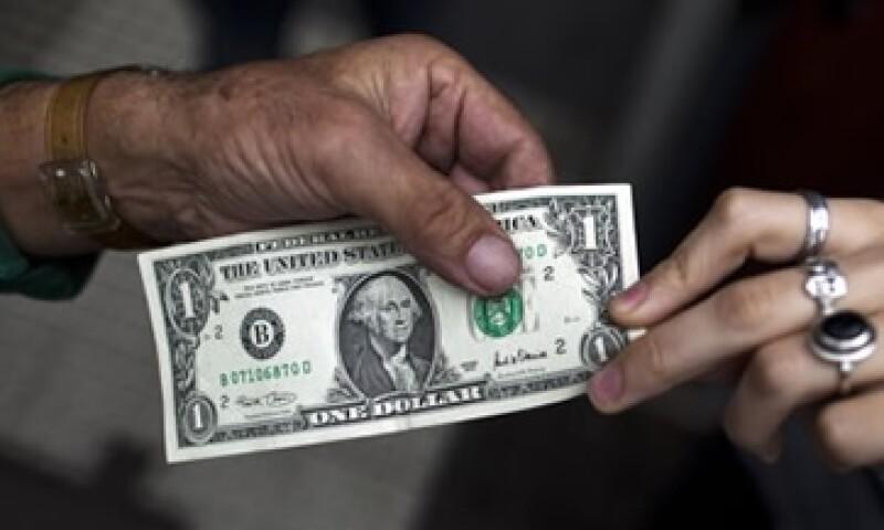 El tipo de cambio podría oscilar entre 12.28 y 12.36 pesos por dólar, estima Banco Base. (Foto: Getty Images)