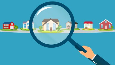 Vector of a business man hand holding magnifying glass searching for the best real estate house deal